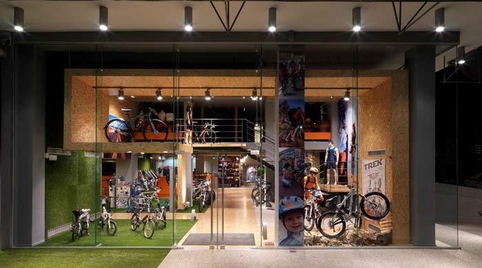 绿色天然草坪自行车店装修设计案例