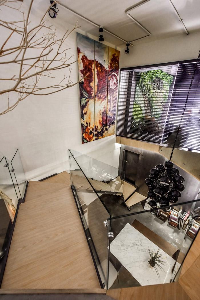 设计师在办公室设计中,以loft风格,自然,工业风为办公室设计关键词图片